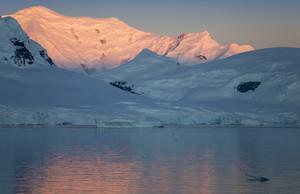 Sunset behind a snowy coast