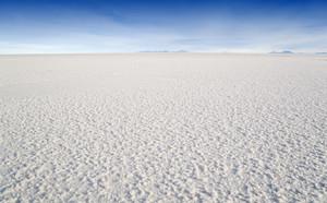 Dry, cracked sand in a vast desert