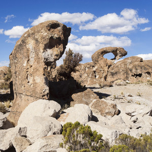 Unique rock formations under a blue sky