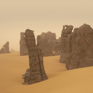 Rock formations in a sandy desert in thick fog