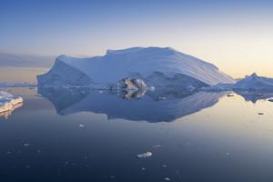 Towering iceberg at dusk
