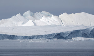 Iceberg against a grey sky