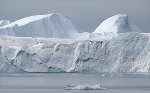 Towering iceberg against a grey sky