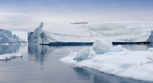 Towering icebergs against a grey sky