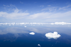 Sunlit ice floes in deep blue water