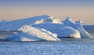 Sunlit icebergs at dawn