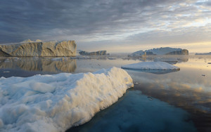 Icebergs and ice floe under a stormy sky