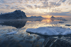 Iceberg and ice floe during a golden sunset