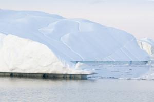 Towering iceberg in soft morning light