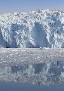 Sunlit iceberg in icy waters along the coast