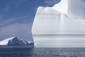 Sunlit icebergs under a blue sky