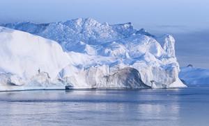 Sunlit iceberg at dawn