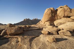 Sun-bleached rocks under a blue sky