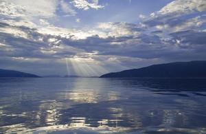 Sunlit lake at dawn