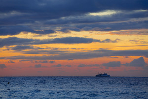 Ship in the ocean during a dramatic sunset