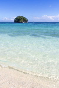 Tropical island in the clear ocean