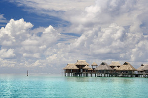 Thatched huts in the tropical ocean