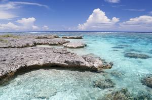 Sunlit rocks on a tropical beach