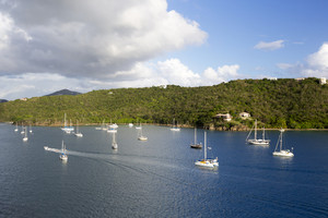 White sailboats along a tropical coast