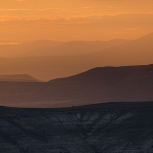 Rolling hills under an orange sunset