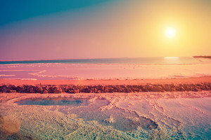 Dead sea salt shore at sunrise
