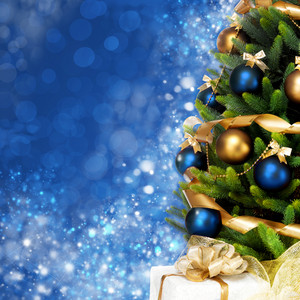 Decorated Christmas tree on blue background