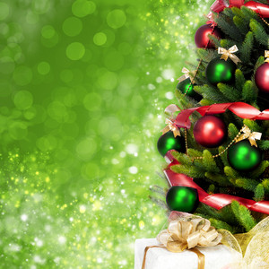 Decorated Christmas tree on green background