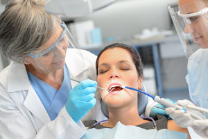 Dental check woman patient professional dentist team open mouth