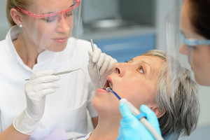 Dental team teeth checkup elderly patient woman open mouth surgery