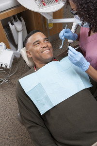 Dentist with patient