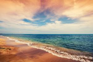 Deserted beach with cloudy sky