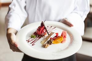 Dessert on chef hand
