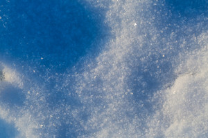 Detail of snowdrift snow texture in close up in good light