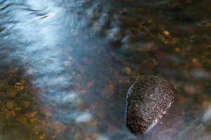 Detail of wild river - water and stone. Wadag river in Olsztyn