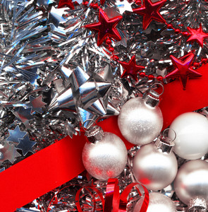 Different Christmas Decorations In Red And Silver Colors