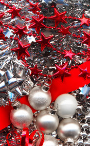 Different Christmas Decorations In Red And Silver Colours