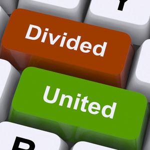 Divided And United Keys Show Partnership Or Teamwork
