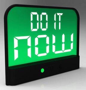 Do It  Now Clock Showing Urgency For Action