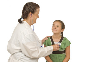 Doctor Examines Smiling Little Girl