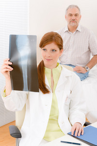 Doctor office - female physician examine patient x-ray