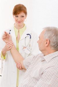 Doctor office - portrait female physician examine senior patient