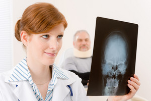 Doctor office - portrait female physician examine x-ray senior patient