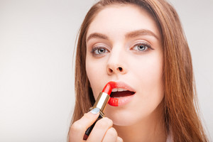 doing makeup with red lipstick only on left part of face