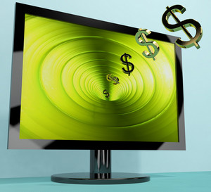 Dollar Symbols Coming From Screen Showing Money Wealth Earnings Or Online Winnings