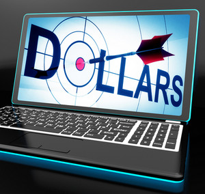Dollars On Laptop Shows Financial Currencies