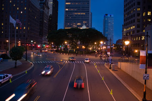 Downtown Hartford Connecticut during the evening hours. The slow shutter speed shows the movement of the traffic.