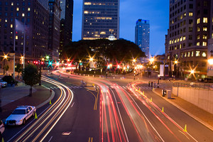 Downtown Hartford Connecticut during the evening hours. Time lapse photography shows the light trails of the cars from the slow shutter speed.