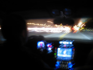 Driving at night in a modern luxury vehicle - abstract light trails with slow shutter speed.