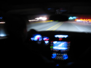 Driving at night in a modern luxury vehicle interior.