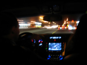 Driving at night in a modern luxury vehicle.